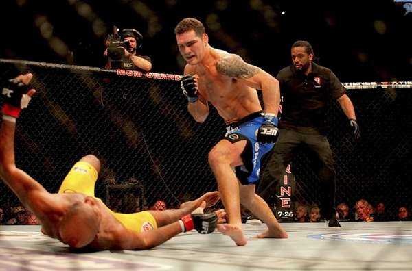 Chris Weidman knocks down Anderson Silva with a