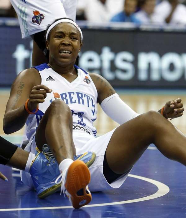 Liberty guard Cappie Pondexter reacts after being called