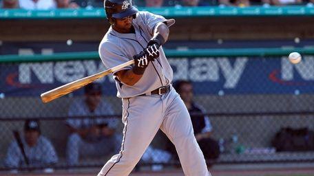 Bridgeport Bluefish hitter Victor Diaz bats during a