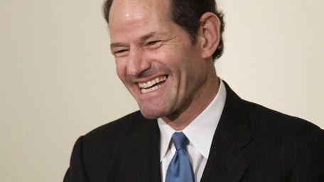 Former New York Gov. Eliot Spitzer addresses an
