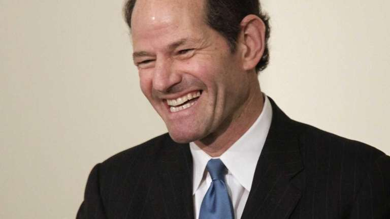 Former New York Gov. Eliot Spitzer addresses an