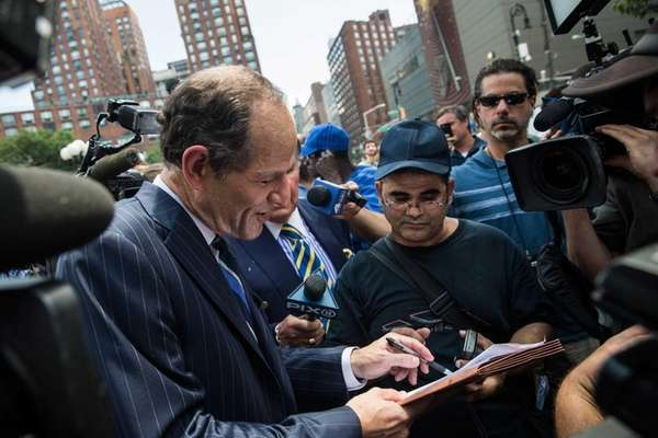 Former New York Gov. Eliot Spitzer collects signatures