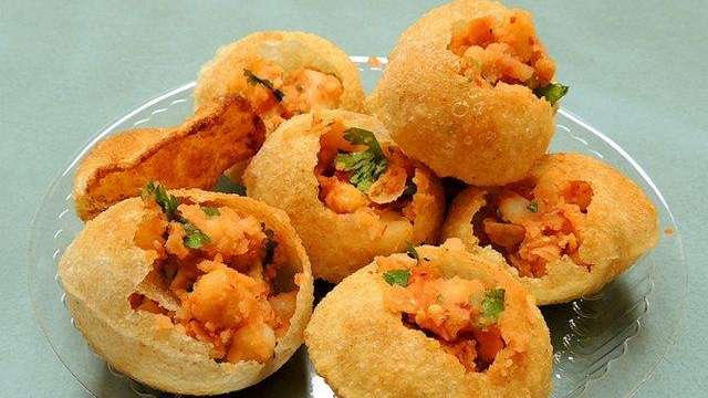 Try Pani Puri, a crispy Indian snack food