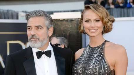 Stacy Keibler and George Clooney. (Getty Images)