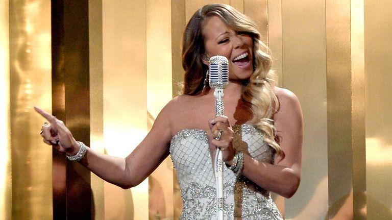 Mariah Carey performs during the 2013 BET Awards