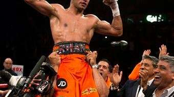 Britain's Amir Khan celebrates after beating Mexico's Julio