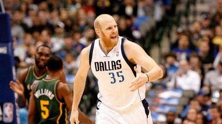 Dallas Mavericks center Chris Kaman (35) looks on