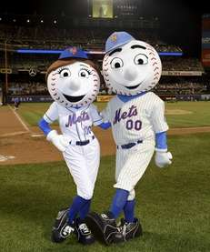 Mrs. Met and Mr Met pose for a