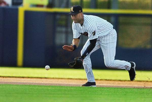 Yankees shortstop Derek Jeter fields a ground ball