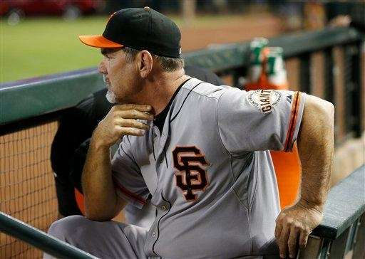 San Francisco Giants manager Bruce Bochy sits in