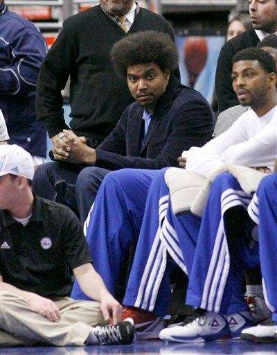 Philadelphia 76ers center Andrew Bynum sits on the