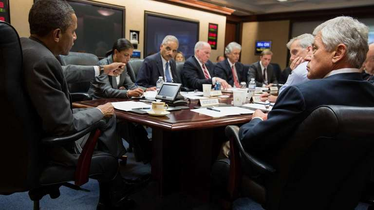 President Barack Obama meets with members of his