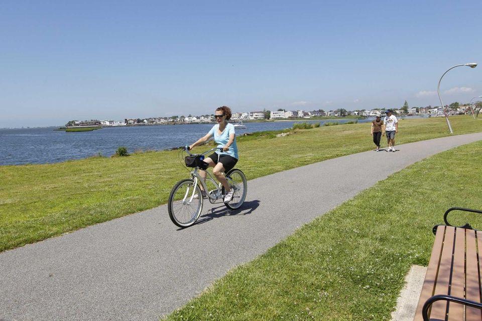 Linda Salerno of Wantagh rolls along the bike,