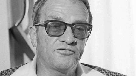 Then-Philadelphia Flyers coach Fred Shero listens to a