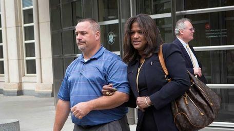 Rose Nemorin, right, widow of slain NYPD detective