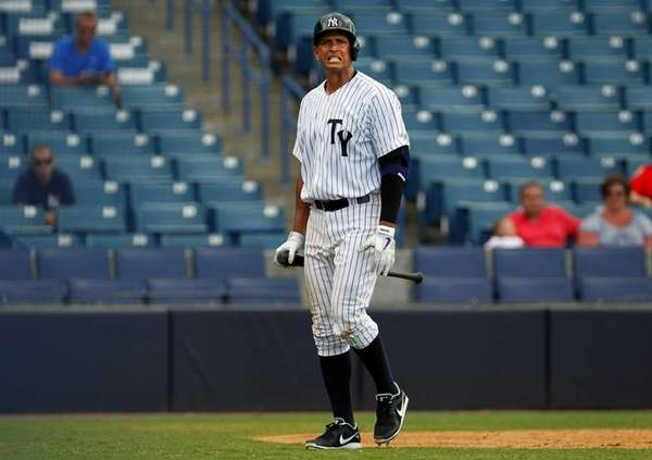 Alex Rodriguez walks back to the bench after