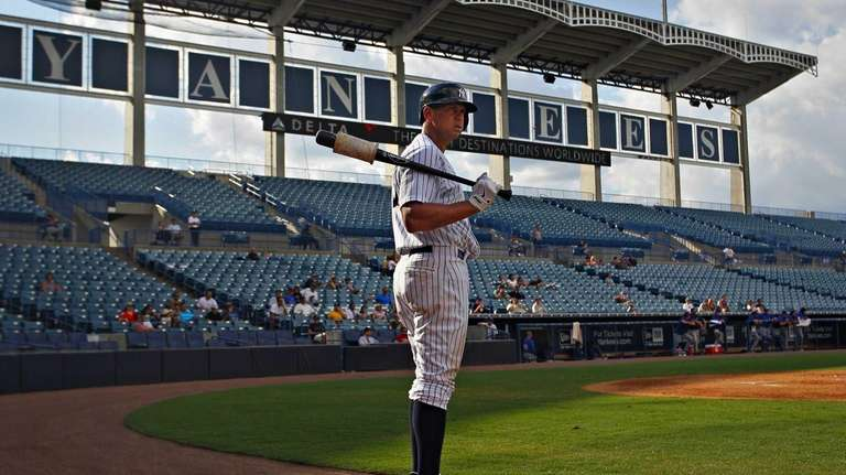Alex Rodriguez awaits his turn at bat with