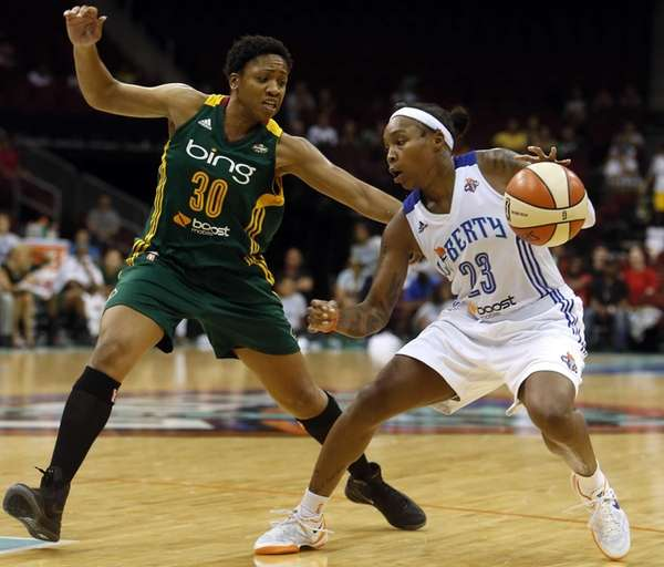 Cappie Pondexter dribbles against the Seattle Storm's Tanisha