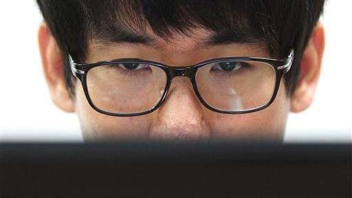 Simon Choi, a South Korean cybersecurity researcher, watches