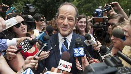 Former New York Governor Eliot Spitzer speaks to