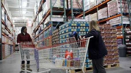 Consumers shop at a Costco Wholesale store. (Getty)