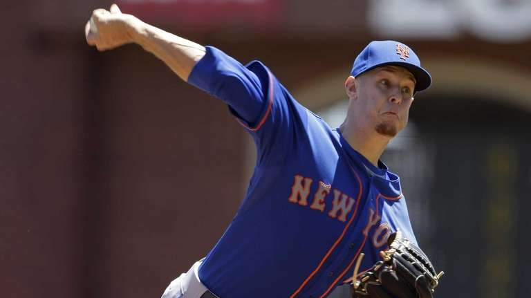Zack Wheeler delivers a pitch during the first