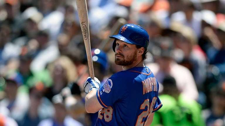Daniel Murphy of the Mets hits an RBI