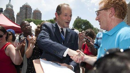 Former New York State Governor Eliot Spitzer speaks