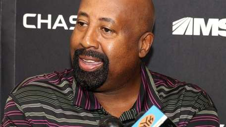 Mike Woodson talks to media at the Knicks'
