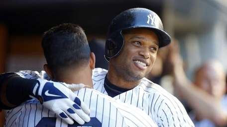 Robinson Cano of the Yankees celebrates his third-inning,