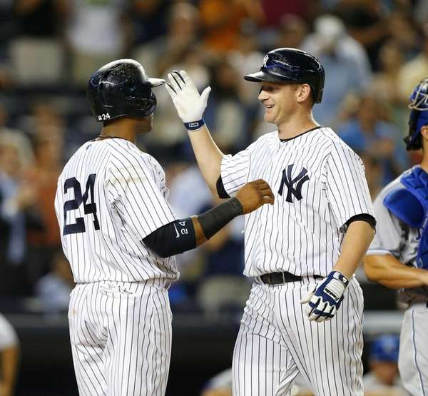 Lyle Overbay of the Yankees celebrates his sixth-inning