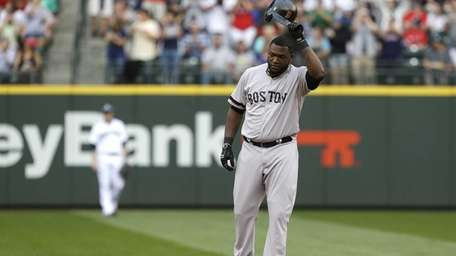 Boston Red Sox's David Ortiz tips his helmet