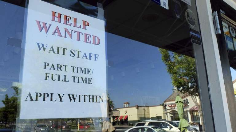 A help wanted sign is displayed in the
