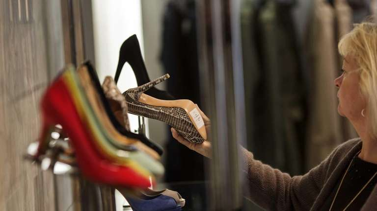 A customer browses shoes at a Coach Inc.