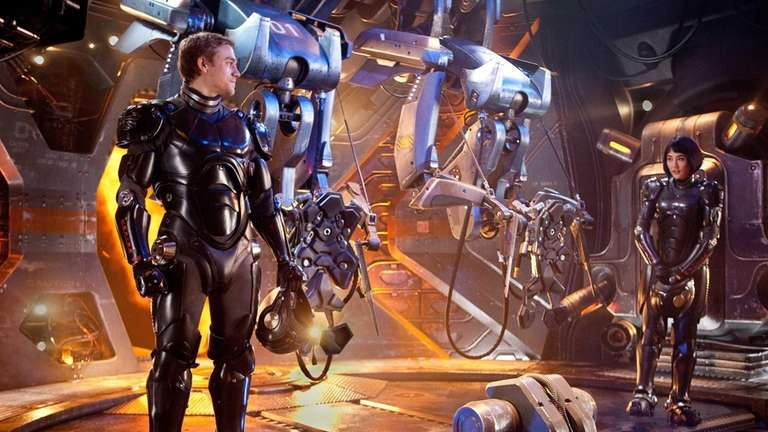 Charlie Hunnam as Raleigh Becket, left, and Rinko