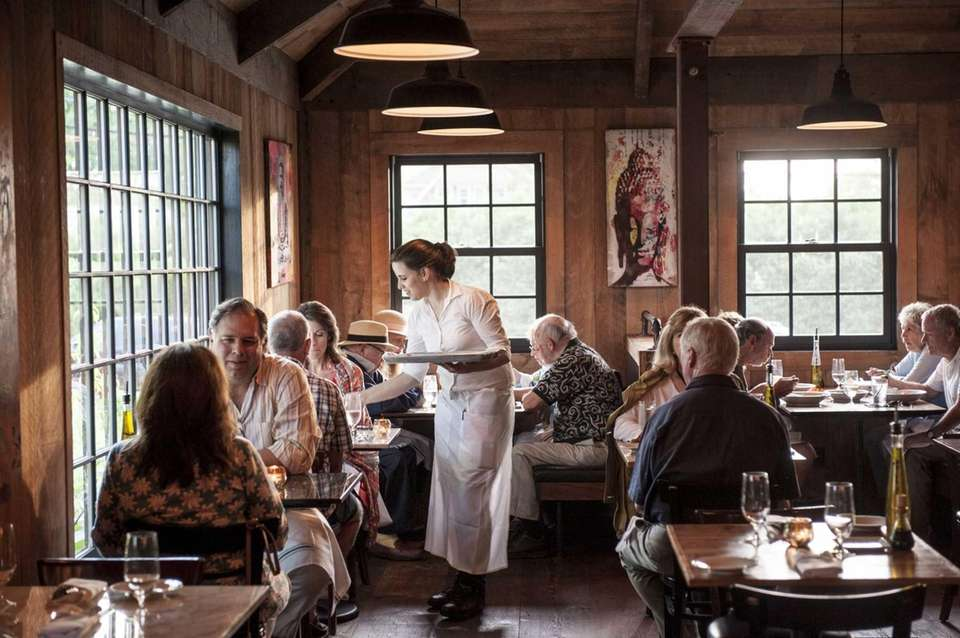 Diners enjoy the rustic interior, with recycled barn
