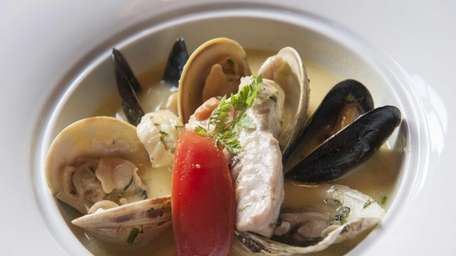 A bouillabaisse is served with steamed north atlantic
