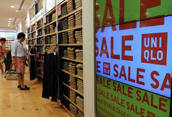 Customers check products at the Uniqlo casual fashion