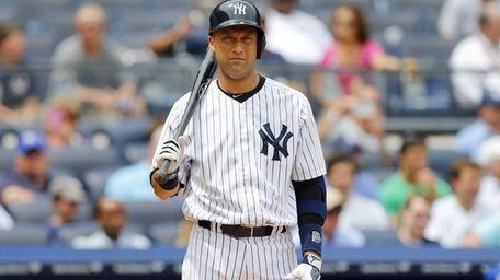 Yankees hitter Derek Jeter looks on during his