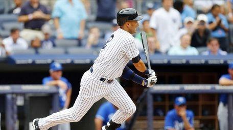 Yankees hitter Derek Jeter follows through on a