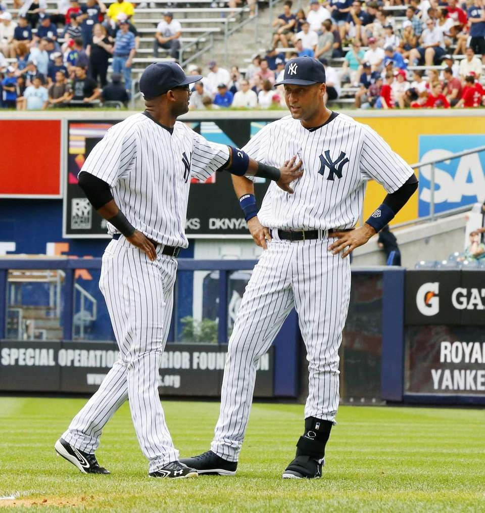 Yankees shortstop Derek Jeter, right, has a laugh