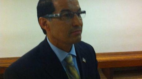 Hempstead Town Clerk Mark Bonilla exits court in