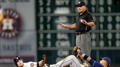John Hirschbeck calls time during the seventh inning