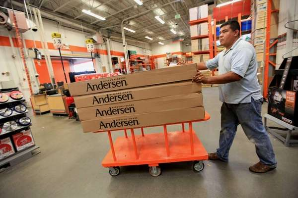 Arturo Zevila, picking up windows at Home Depot