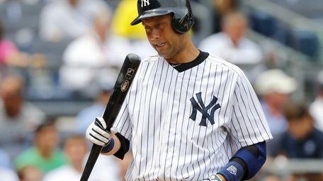 Derek Jeter grimaces during a game against the