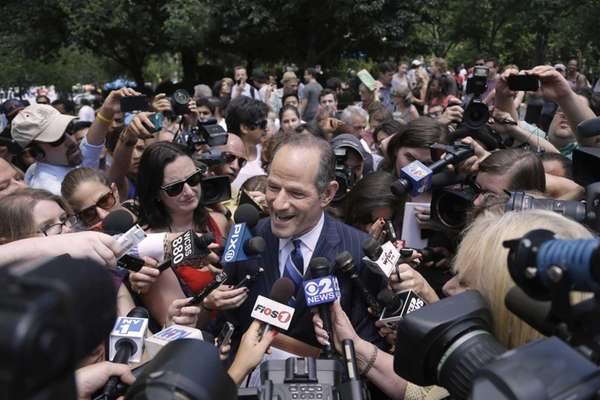 Former New York governor Eliot Spitzer is surrounded