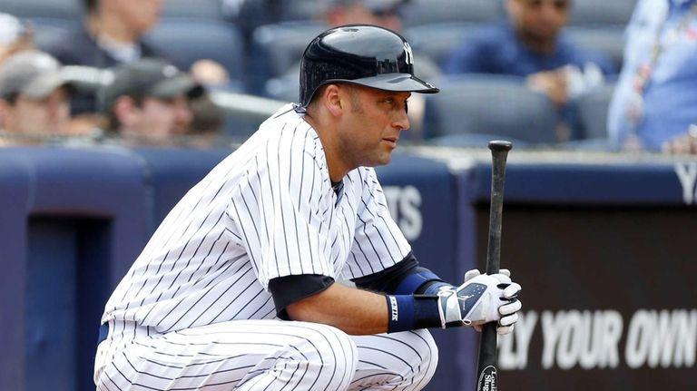 Derek Jeter waits to bat during a pitching
