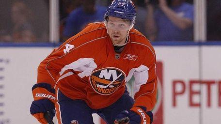 Griffin Reinhart of the Orange Team skates during