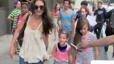 From left, Katie Holmes, her 7-year-old daughter, Suri