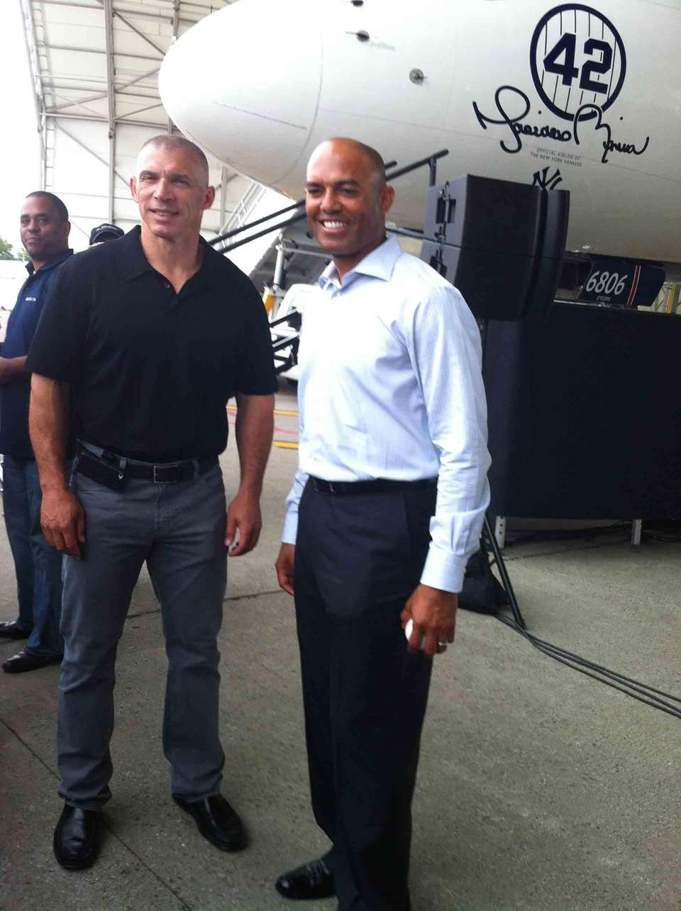 Yankees closer Mariano Rivera poses with manager Joe